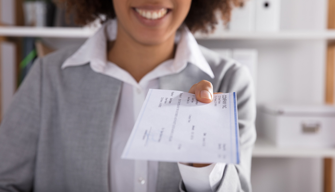 female executive receiving her paycheck as compensation for her work