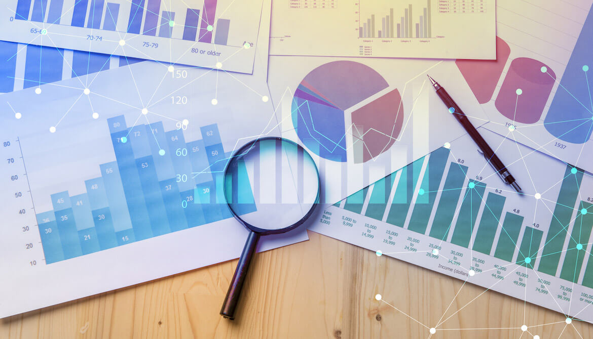 Magnifying glass with papers with data