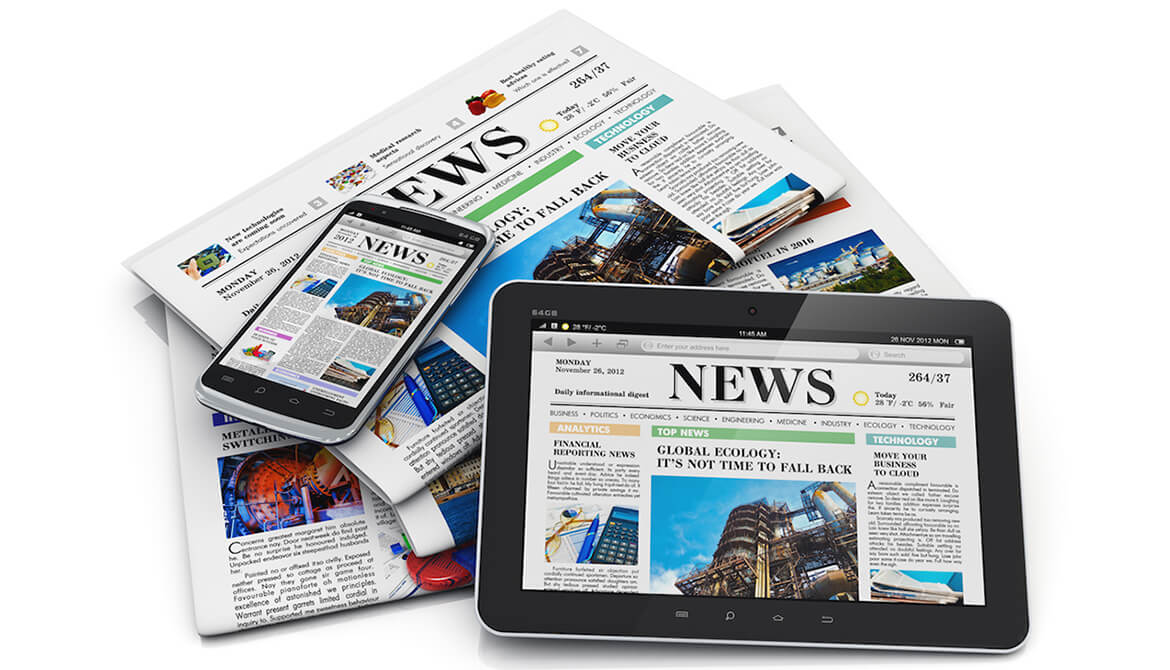 media news displayed on tablets and newspapers