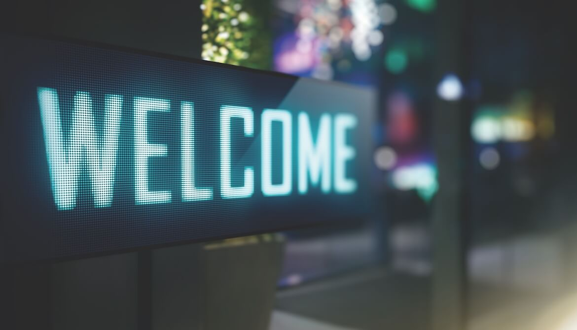 Digital sign displaying WELCOME