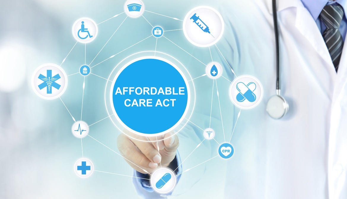 Doctor tapping Affordable Care Act on virtual screen
