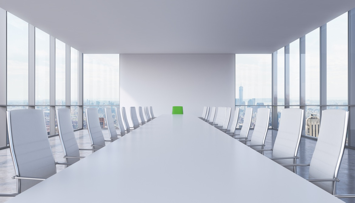 White modern conference room with a green chair in a head of the table