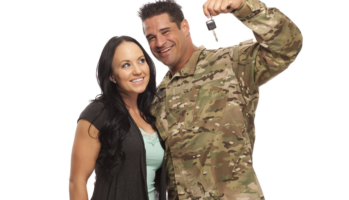 service man in fatigues with car keys and beautiful woman