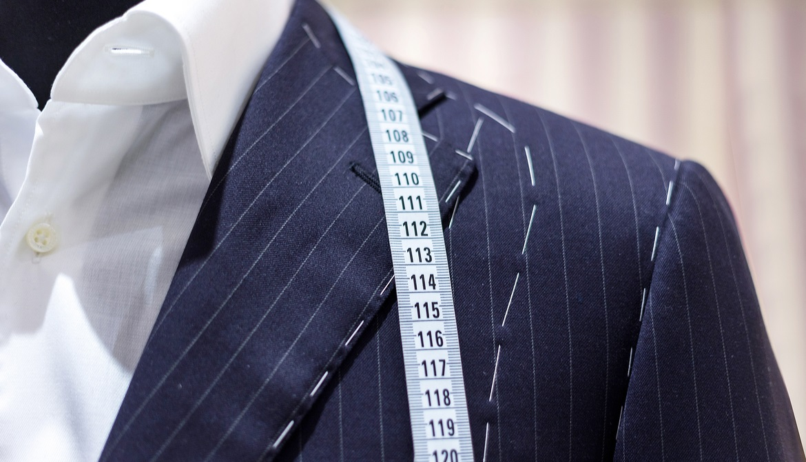 suit on mannequin with tailor's marks and measuring tape