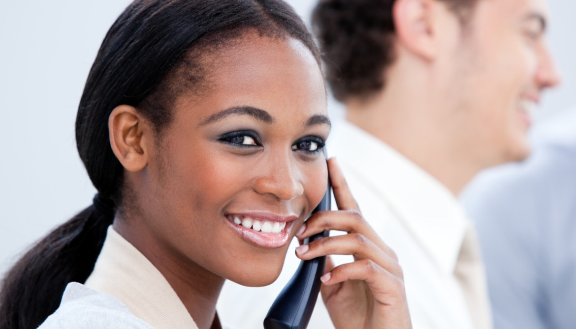 african-american business woman smiling while on the phone