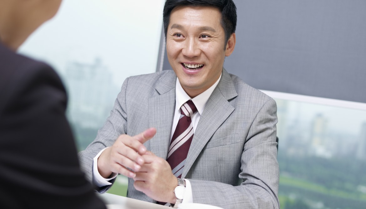 asian executive being interviewed