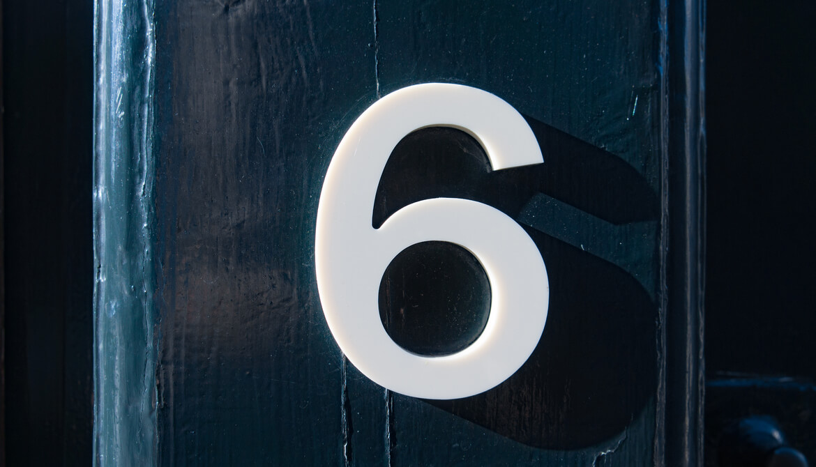 number six on a blue wooden door