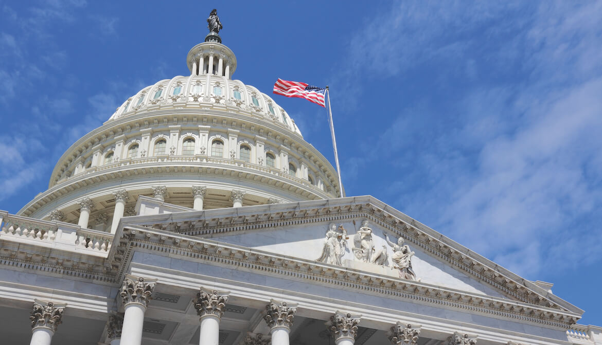 US Capitol Building with flag