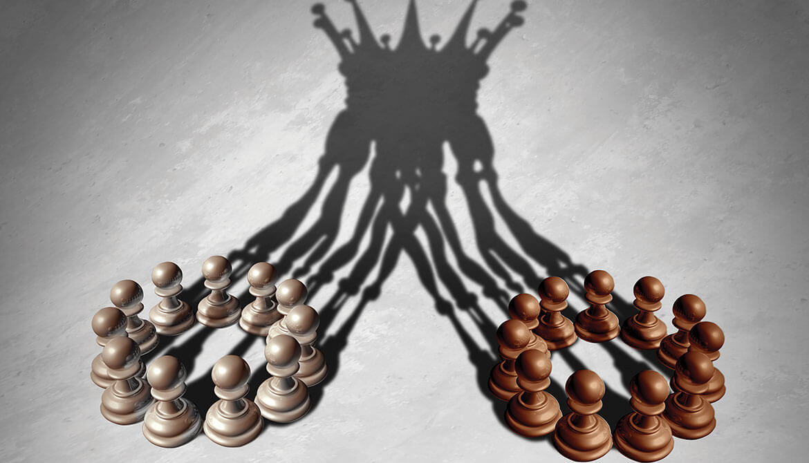 shadows of many chess pawns merging to create the image of a queen