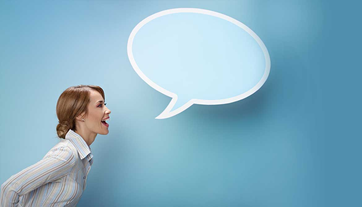 Woman speaking assertively with a blue speech bubble