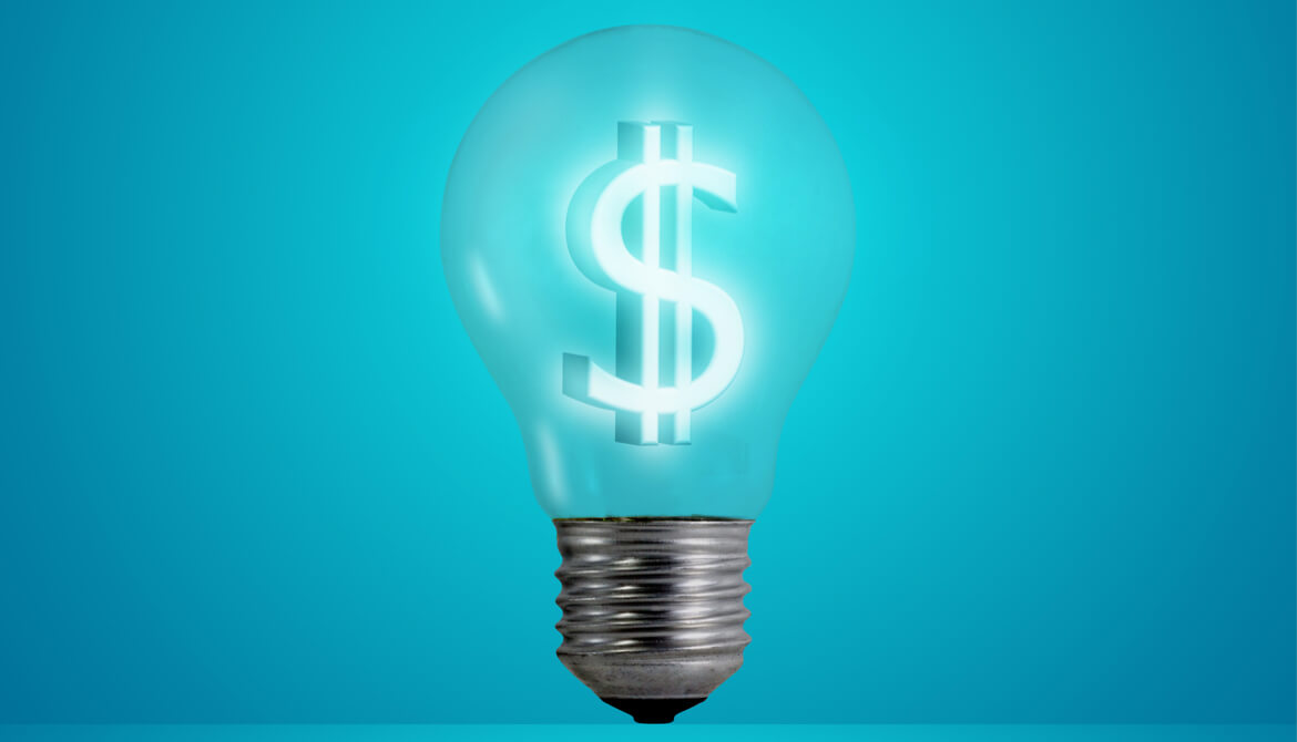 glowing lightbulb with dollar sign filament