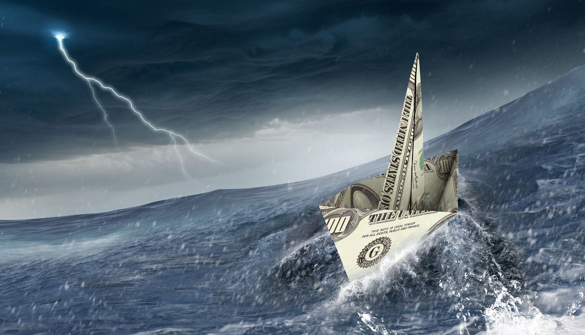dollar bill origami boat sails into a storm on rough waters