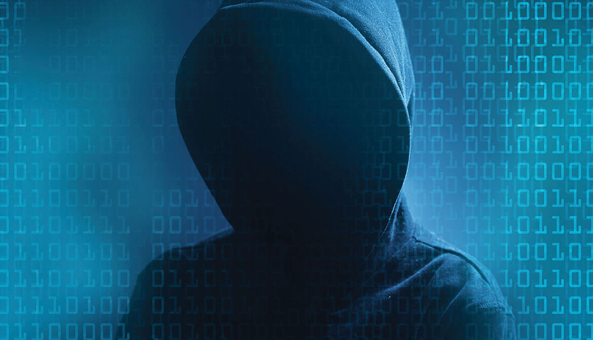 shadowy hacker figure in a dark hoodie