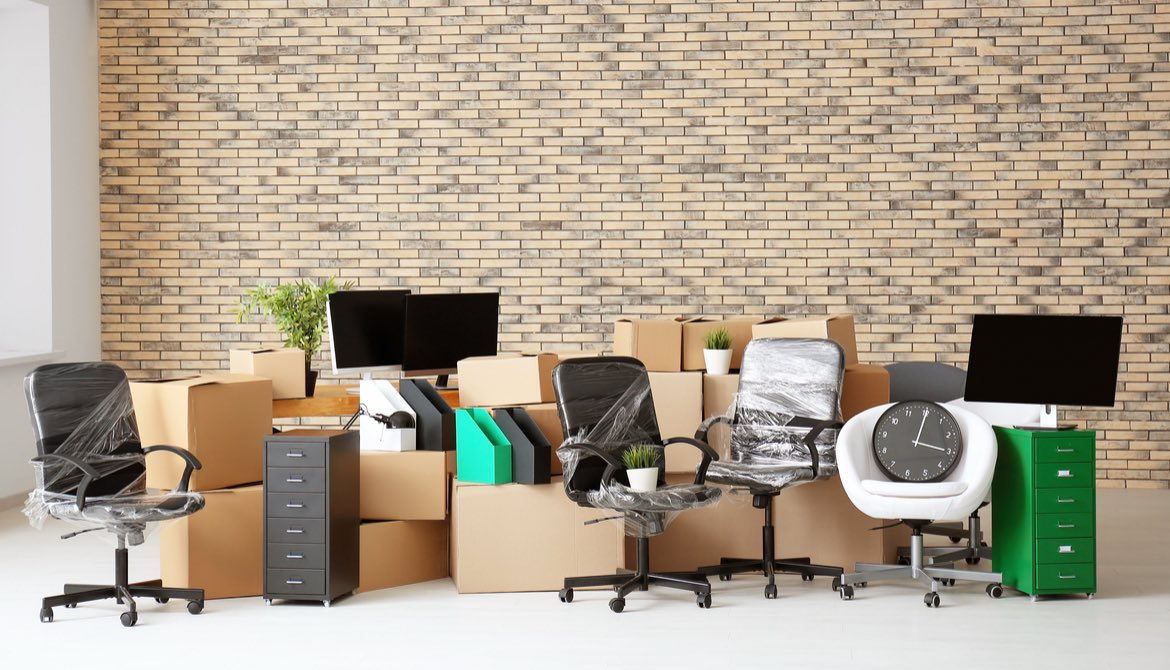 packed boxes and furniture in new office space