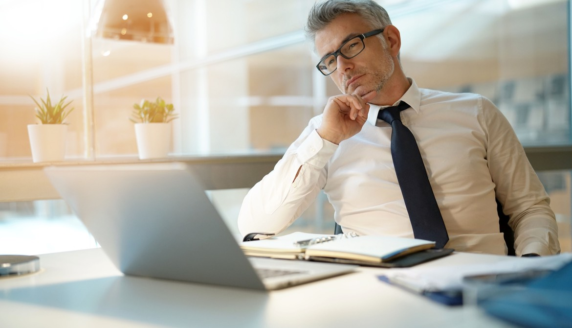 lender working with laptop, looking worried
