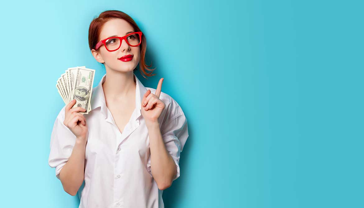 thoughtful young woman wearing glasses and holding several 100 dollar bills