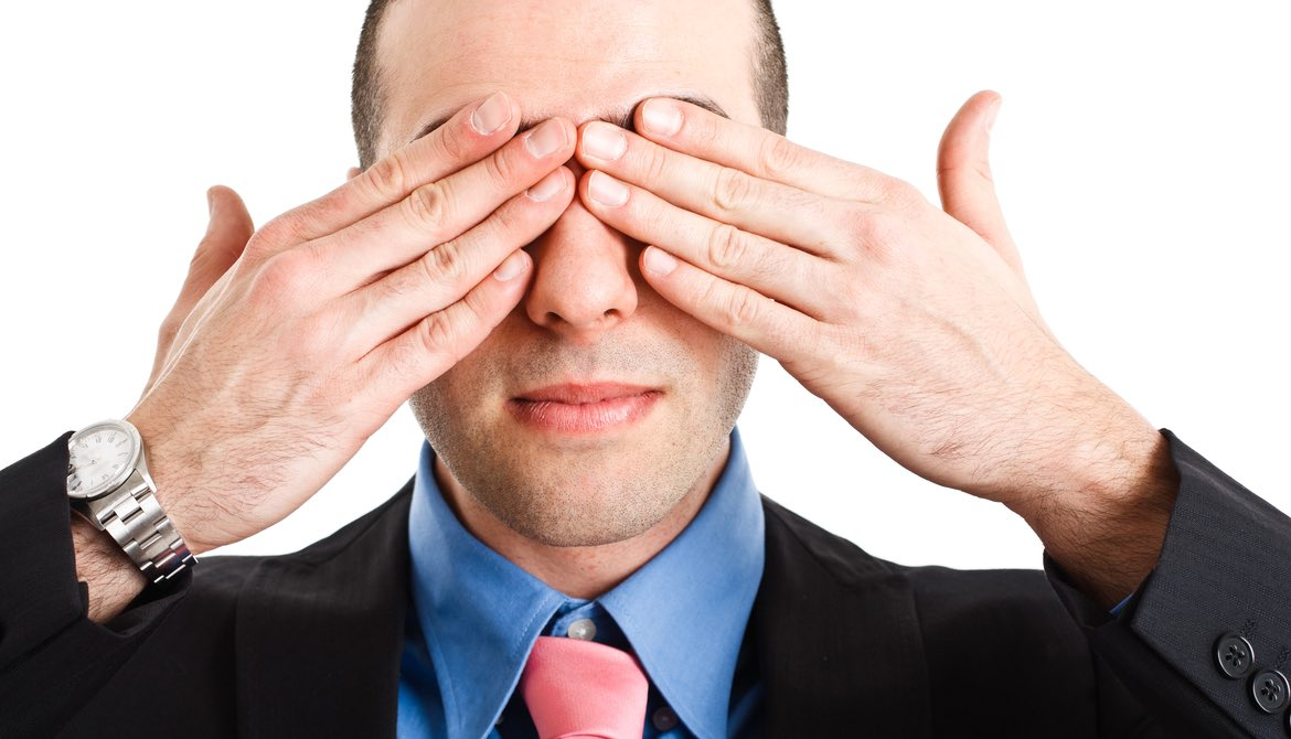 executive covering his eyes with his fingers