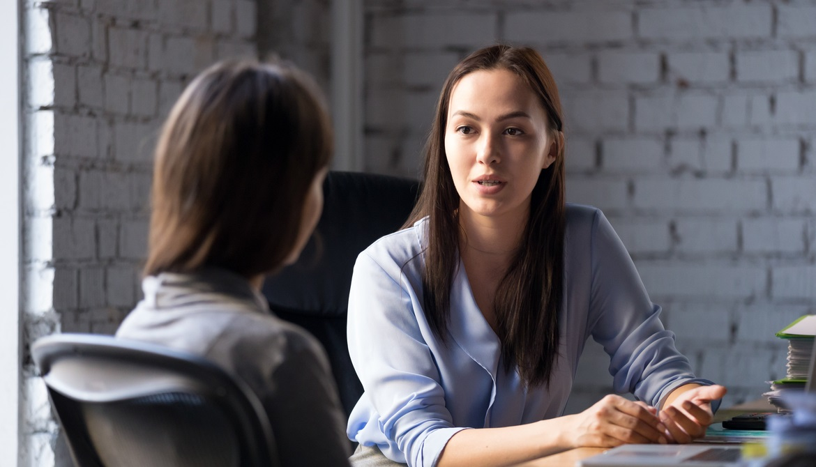 young female financial advisor counseling credit union member