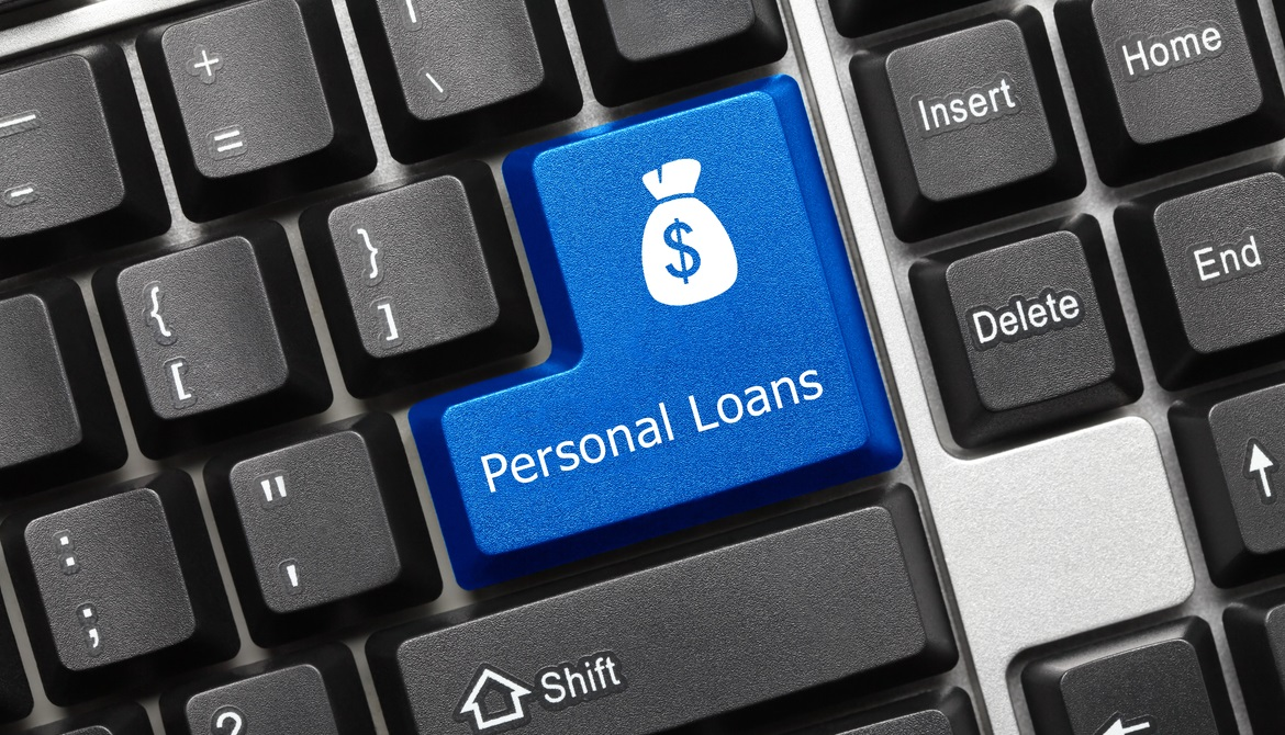 keyboard with blue return key with the words personal loan