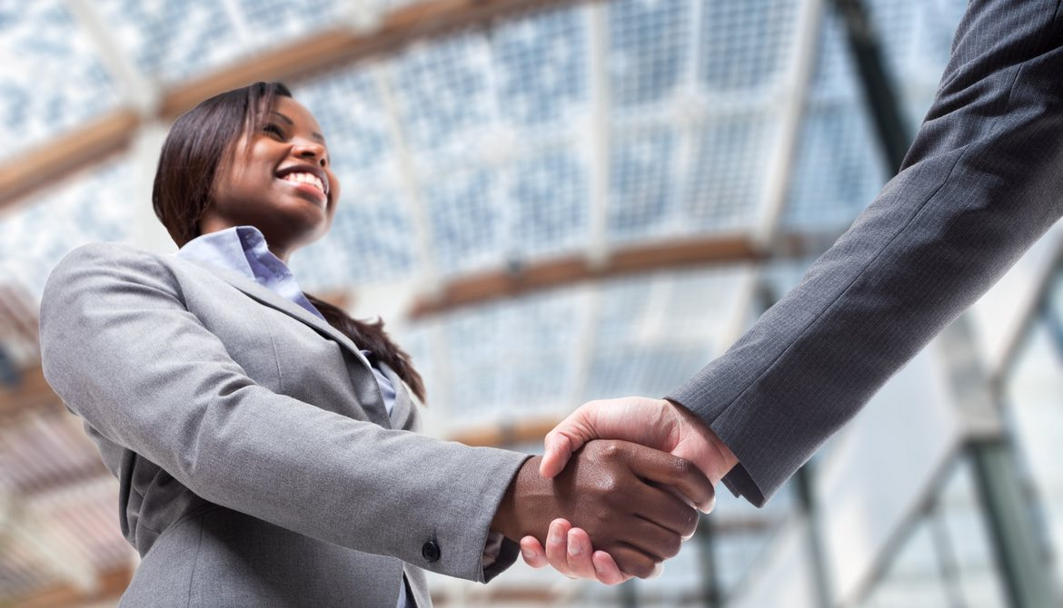 female african american executive shaking hands with a colleague