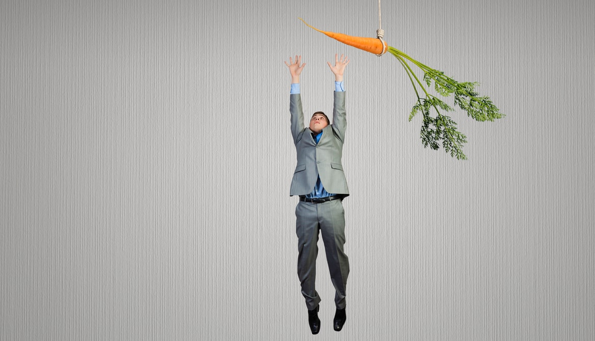 Funny image of businessman jumping for a carrot