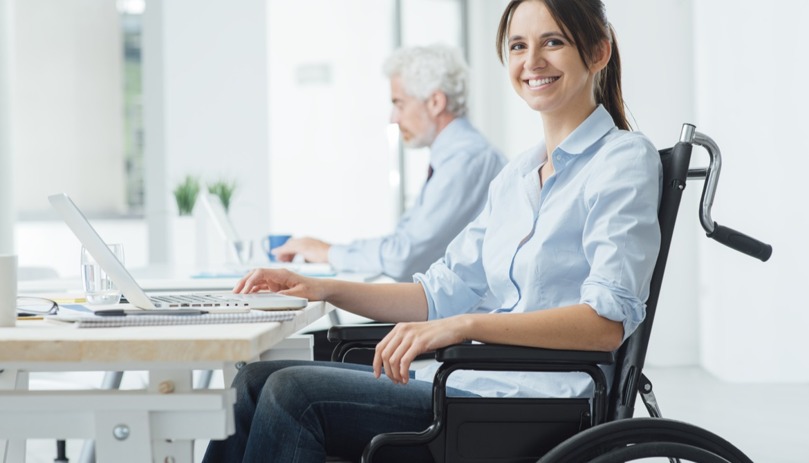 confident female employee using a wheelchair