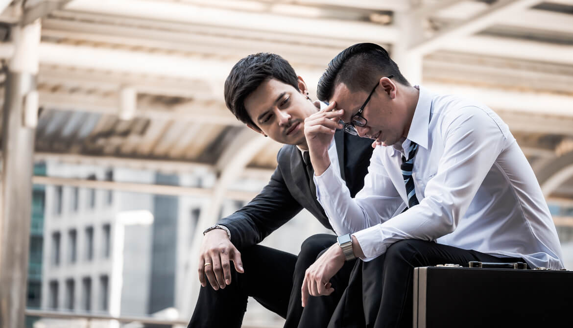 business manager reassures frustrated and upset employee