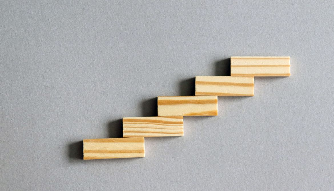 five wooden blocks form graph