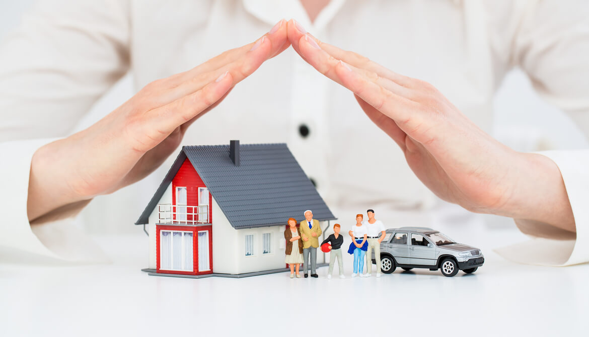 credit union insurance agent protects model house family and car with her hands