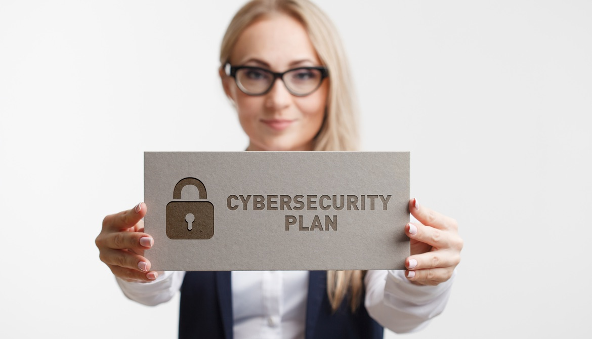 cybersecurity plan sign held by woman