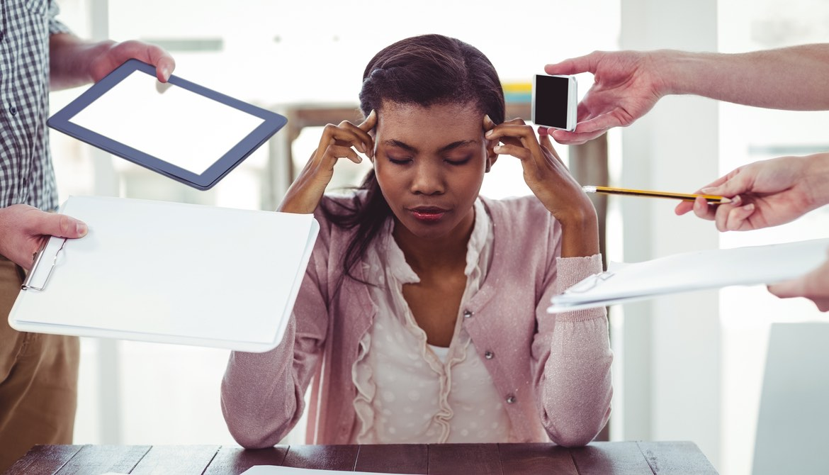 stressed businesswoman not being product due to too many interruptions