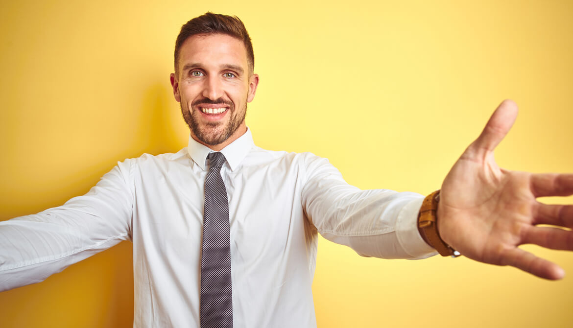business man with arms out for embrace