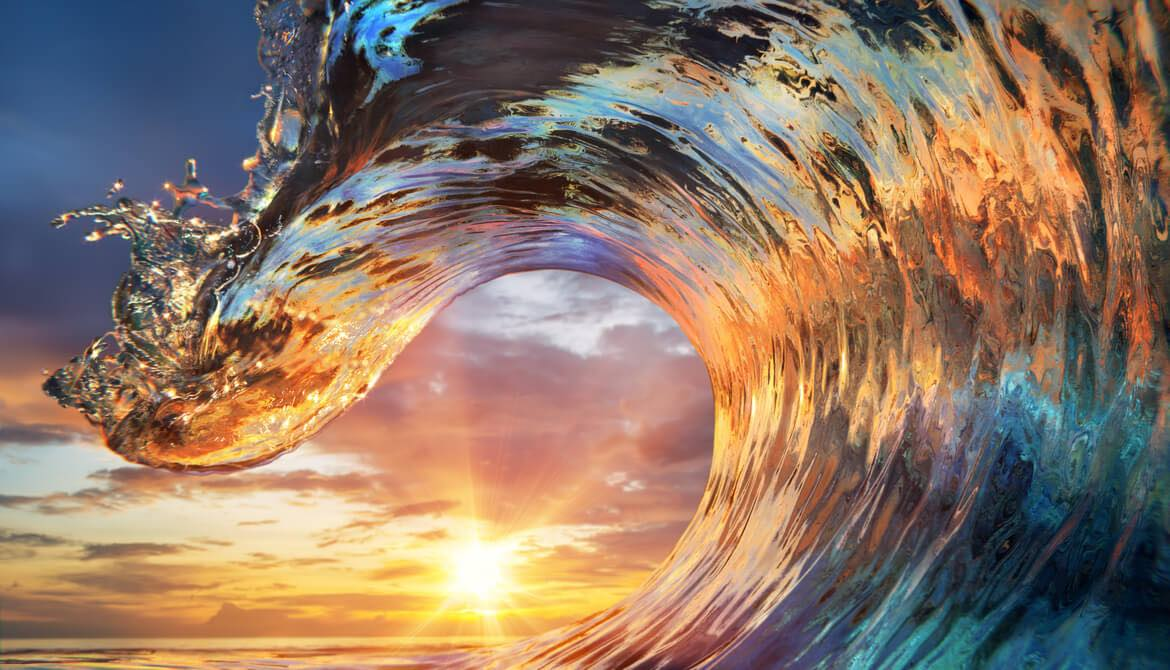 colorful ocean wave at sunset
