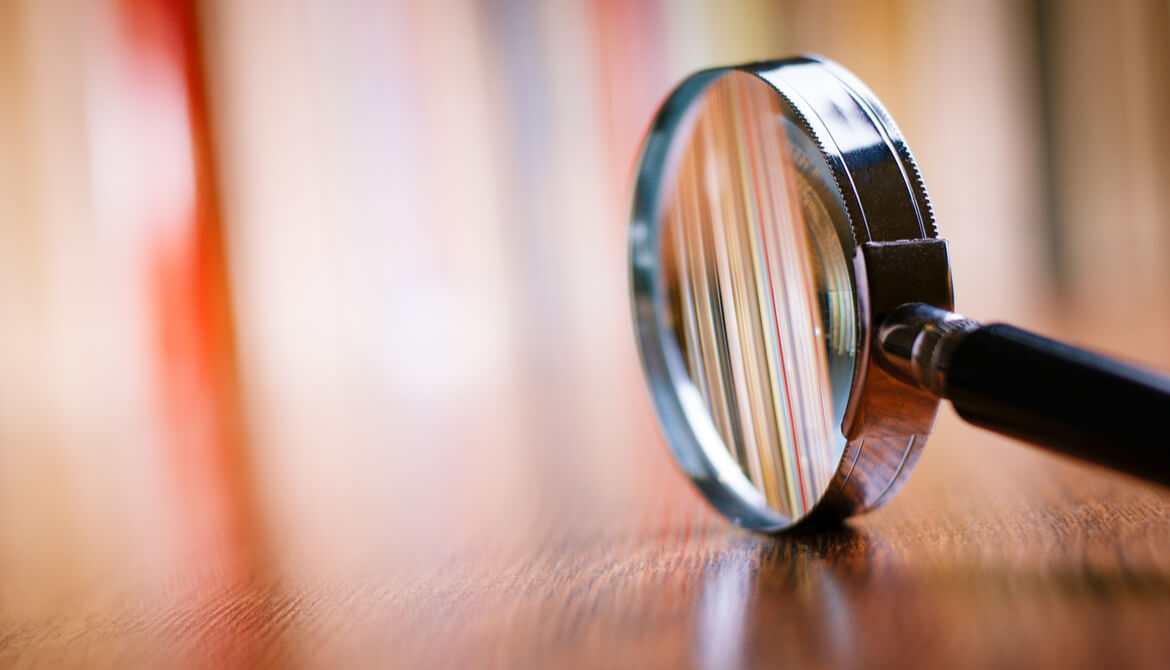 magnifying glass on table with blurred background