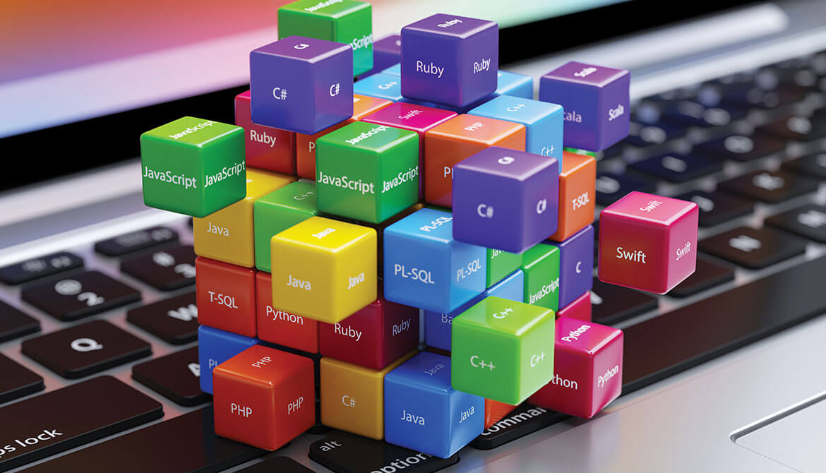 colorful blocks and cubes labeled with technology and programming language names connected together on top of laptop keyboard