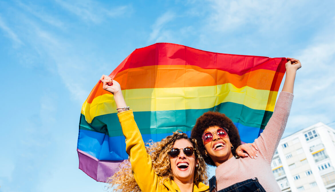 two women fly pride flag