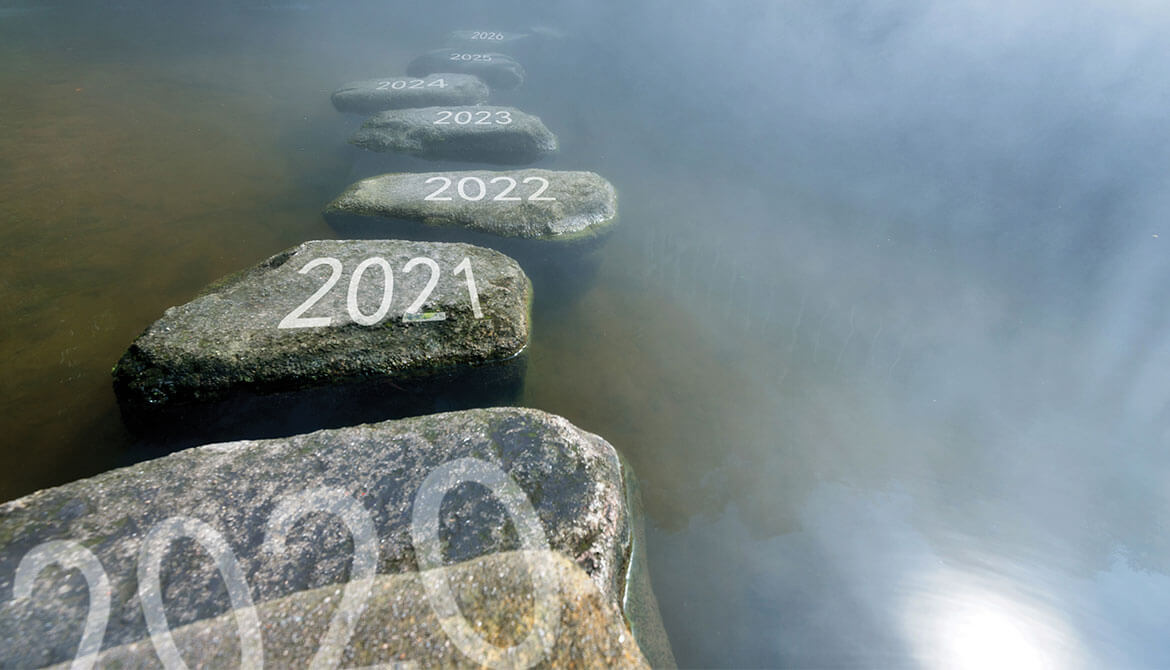 stepping stones labeled with 2021 and subsequent years crossing a misty river
