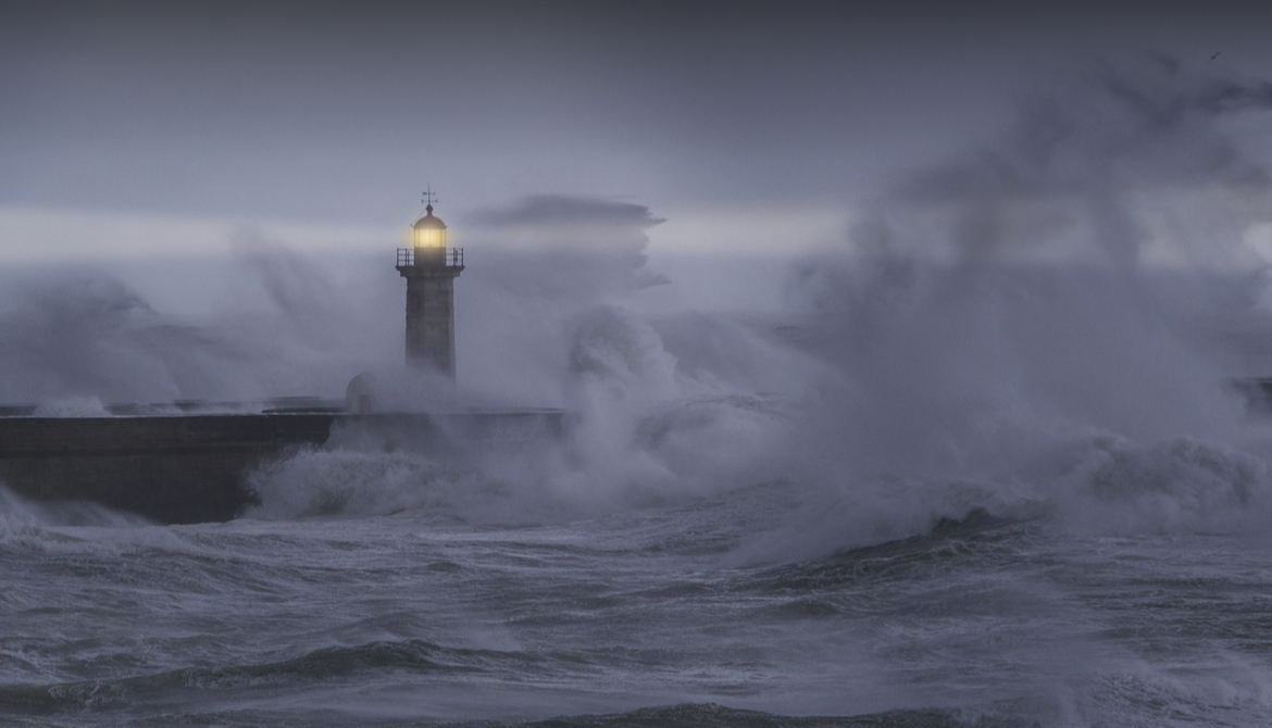 a beacon on a lighthouse in a storm