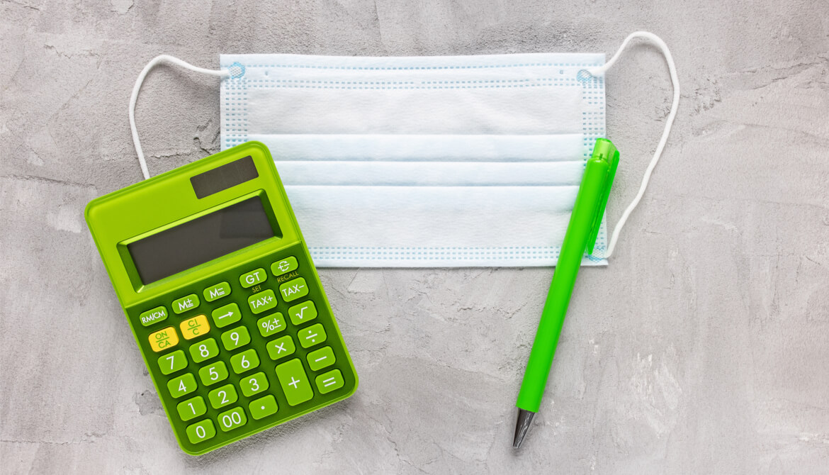 mask, calculator and pen