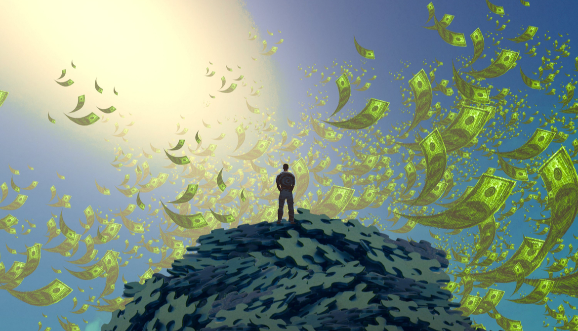 man standing on mountain of puzzle pieces with money in the air around him