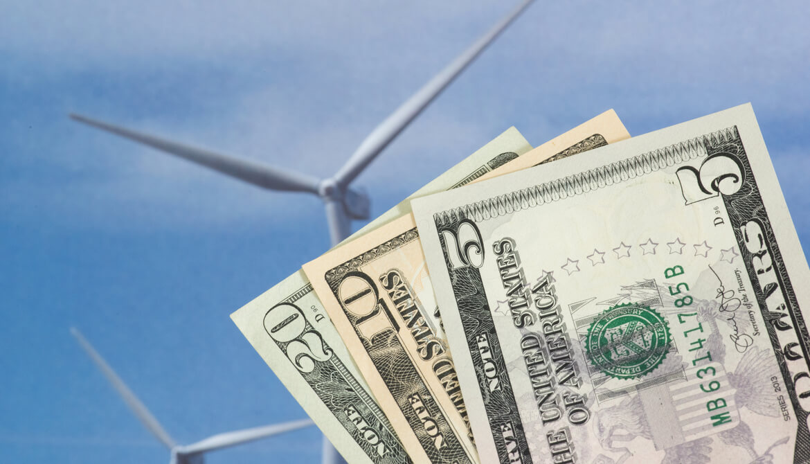 dollars with a wind turbine