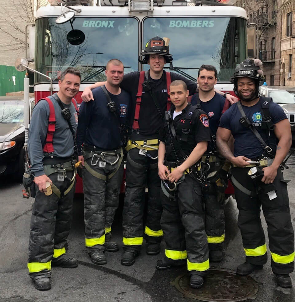 firefighters smiling at the camera