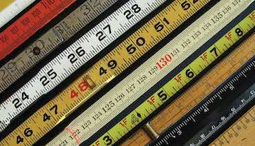 collection of colorful old wooden rulers