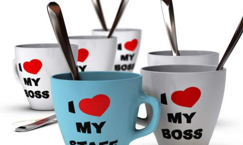 "Collection of white and blue mugs that say ""I heart (sic) my staff"" and ""I heart (sic) my boss"""