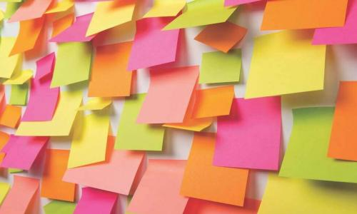 a wall covered in colorful sticky notes