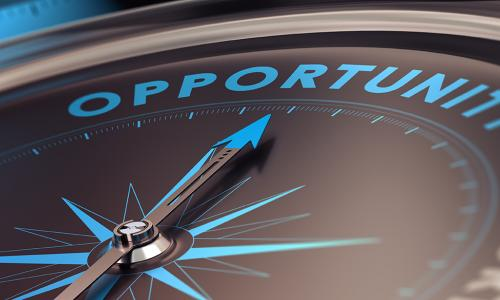 Compass with needle pointing the word opportunity