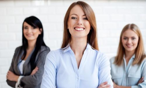 Three business women smiling