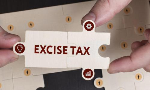 puzzle pieces fit together to spell out excise tax