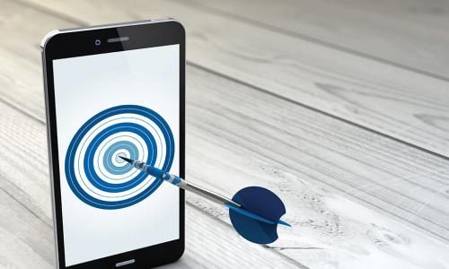 smartphone displaying a bullseye with a dart sticking out of the screen