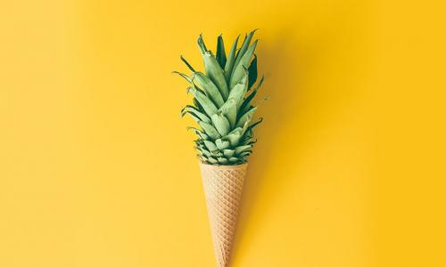 pineapple growing out of an ice cream cone